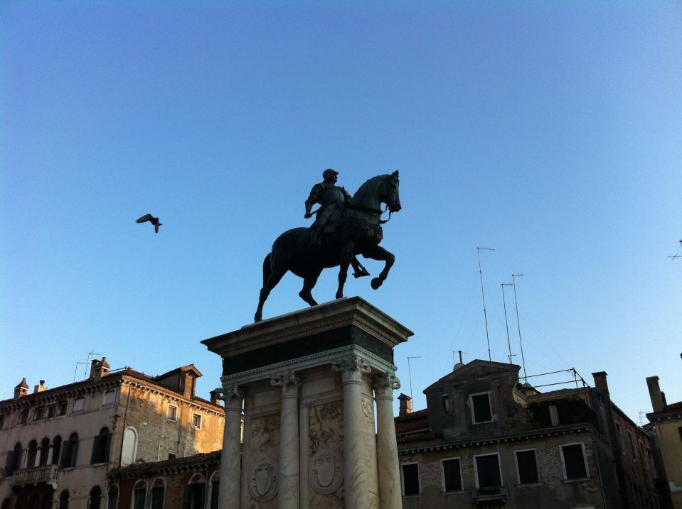 Colleoni statue with bird, evening.