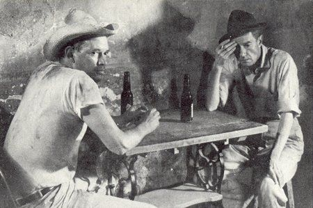 Juan Rulfo (left) and Abel Quezada having a beer, in a scene from 'En este pueblo no hay ladrones' based on a short story by Gabriel García Márquez.