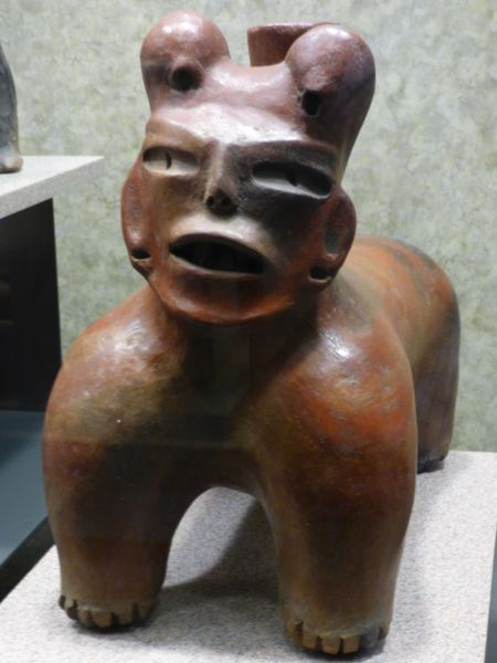 Dogs (such as this one, in the Museum of Anthropology, Mexico City) guided their people to the next world in Aztec culture.