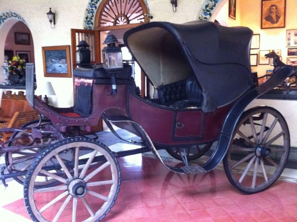 Carriage in foyer of the Posada de Coatepec, used by formerly Important People.